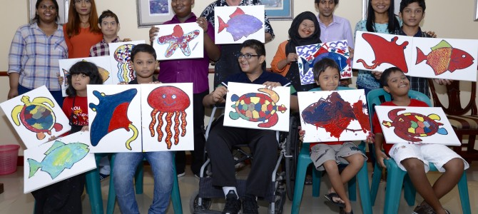Child Advocacy Network of Disability Organizations (CAN DO) holds an art activity with Christopher Hogan as part of children's day celebrations